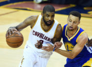 Jun 8, 2016; Cleveland, OH, USA; Cleveland Cavaliers guard Kyrie Irving (2) drives to the basket against Golden State Warriors guard Stephen Curry (30) during the first quarter in game three of the NBA Finals at Quicken Loans Arena. Mandatory Credit: Bob Donnan-USA TODAY Sports ORG XMIT: USATSI-269458 ORIG FILE ID:  201600608_pjc_sd2_153.JPG