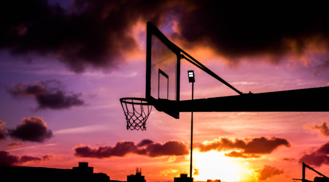 Outdoor Basketball Court in Evening